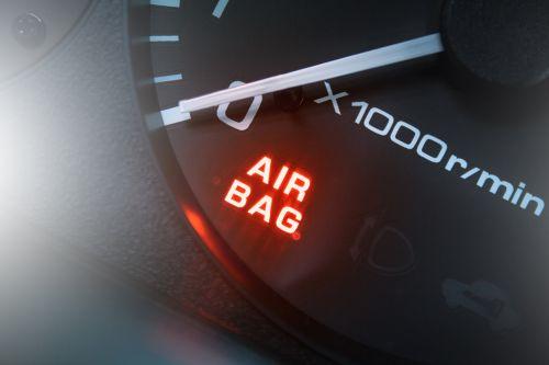 Red air bag light in car